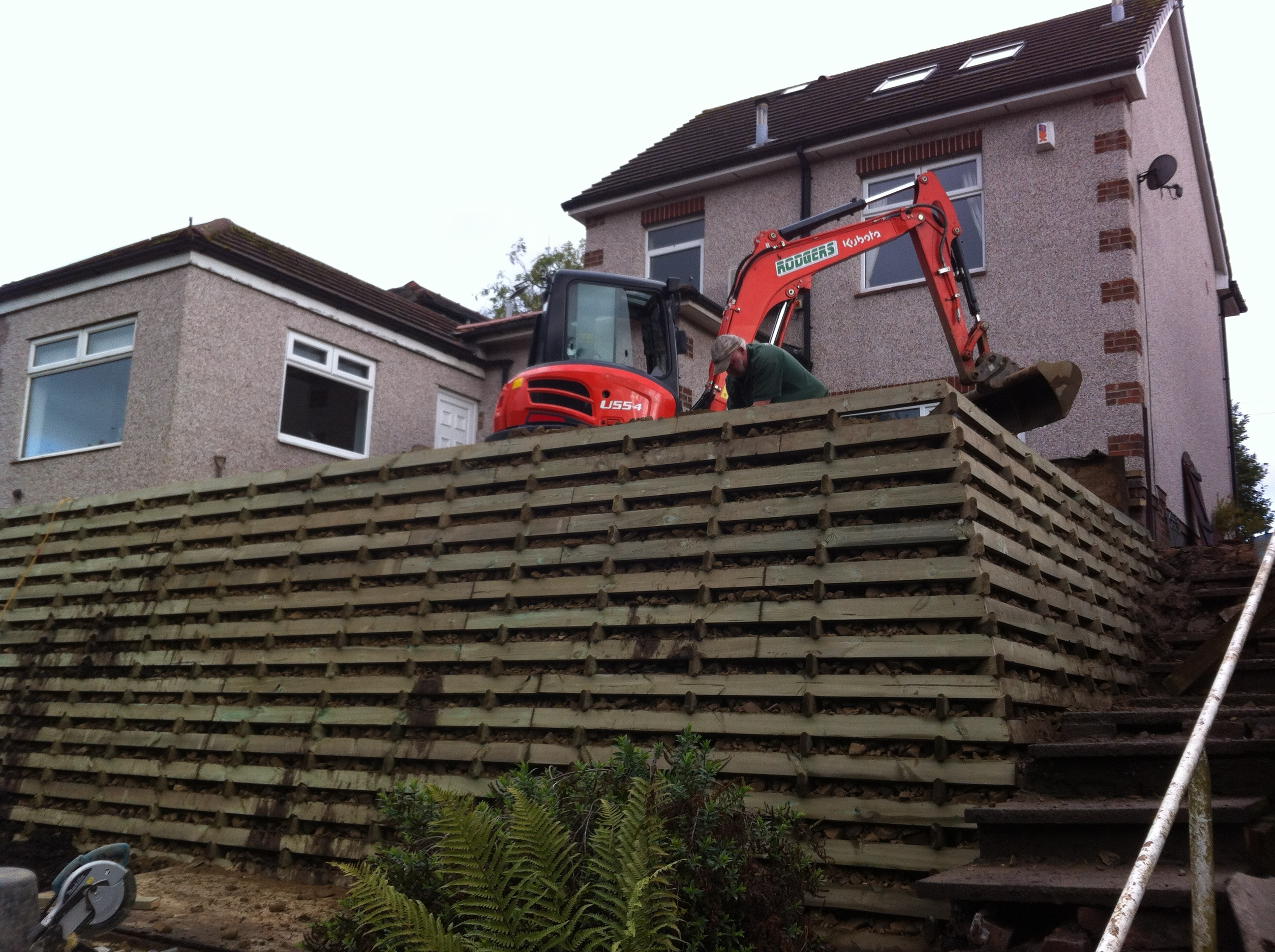 Timbalok timber crib retaining wall installed by Country Landscapes Ltd